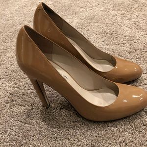 Michael Kors patent leather nude pumps